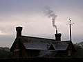Chimneys and wind vane at Denny Lodge, New Forest - geograph.org.uk - 97165.jpg