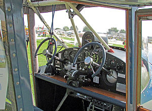 """Chrislea Super Ace - Cabin detail showing the unusual twin """"steering wheel"""" controls jutting out from the instrument panel"""