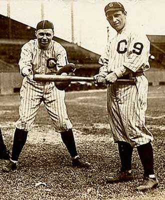 Number (sports) - Players of the Cleveland Indians wearing uniforms with numbers on their left sleeves in 1916. The Indians were the first team to introduce numbered uniforms in the MLB