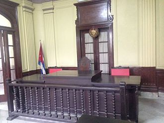 Judicial system of Cuba - In this Havana courtroom, the professional judge sits in the chair at the center of the bench with the two lay judges at either side.