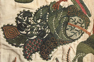 Crewel embroidery - Fanciful leaf in crewelwork, detail of a curtain, English, c. 1696. Victoria and Albert Museum T.166-1961.