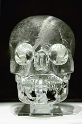 A crystal skull, shining under the light.