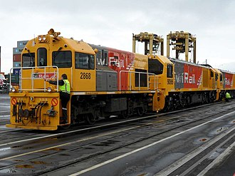 New Zealand DH class locomotive - DH 2868 shunting two new DLs at Port of Auckland.