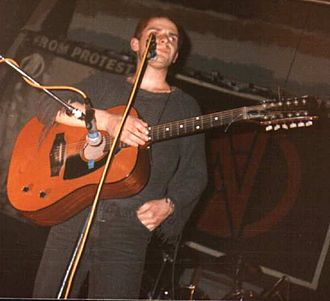 Folk punk - Chumbawamba vocalist Danbert Nobacon pictured playing live at the University of Leeds, 1986, supporting Conflict.