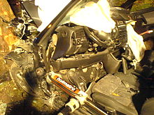 Road Accident By Night; The Forward Block (motor And Dashboard) Is Pushed  Away With An Hydraulic Piston