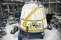 Dragon spacecraft in a cleanroom at SpaceX headquarters.jpg