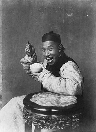 Convention (norm) - In the 19th century and early 20th century, photographs did not often depict smiling people in accordance to cultural conventions of Victorian and Edwardian culture. In contrast, the photograph Eating Rice, China reflects differing cultural attitudes of the time, depicting a smiling Chinese man.