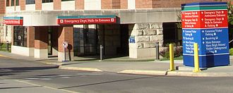 Emergency department - The emergency department entrance at Mayo Clinic's Saint Marys Hospital. The red-and-white emergency sign is clearly visible.