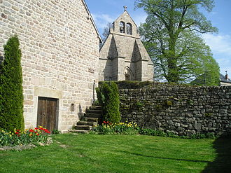 Gentioux-Pigerolles - The church seen from behind the Royal Notary hotel