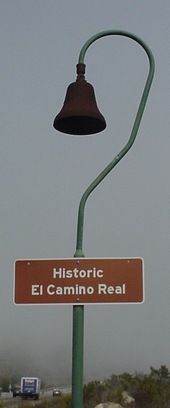 Distinctive route markers with symbolic mission bell and shepherd's