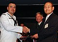 Equipment Operator 1st Class Mario Gonzalez, of Los Angeles, recieves an award from Mr. Chul-soo Han, President of the Korea-America Friendship Society.jpg