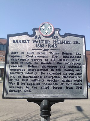 Ernest Holmes Sr. - It is on the original site of Holmes's garage and later his workshop that assembled his wreckers