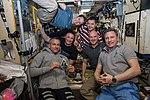 Expedition 57 crew gathers inside the Zvezda Service Module.jpg