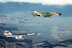 69th Fighter Squadron - An F-4C-15-MC Phantom II (s/n 63-7420), top, and a German Lockheed F-104G Starfighter (63-13269) aircraft on a training mission from Luke AFB