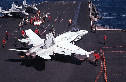 A Marine F/A-18 from VMFA-451 preparing to launch from USS Coral Sea (CV-43) F-18A Hornet VMFA-451 USS Coral Sea 1989.jpeg