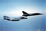 F-4J of VMFA-115 in flight with French Mirage F1 1981.jpg
