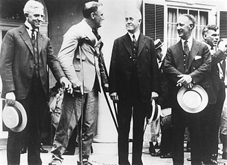 Paralytic illness of Franklin D. Roosevelt - Roosevelt supporting himself on crutches at Springwood in Hyde Park, New York, with visitors including Al Smith (1924)