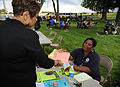 FEMA - 44448 - FEMA Community Relations Specialist Works with Flood Survivor in TN.jpg