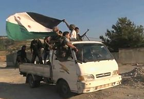 FSA soldiers in truck moving.jpg