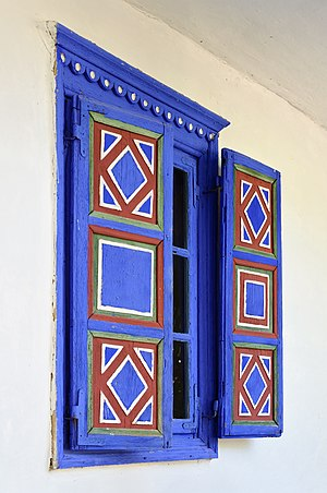 Window shutter - Brightly colored shutters in Romania