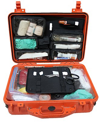 Survival skills - A first aid kit containing equipment to treat common injuries and illness