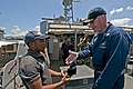 Flickr - Official U.S. Navy Imagery - CO gives a ball cap..jpg