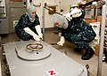 Flickr - Official U.S. Navy Imagery - Sailors dog down a water tight hatch..jpg