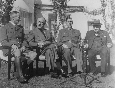 Free French Generals Henri Giraud (left) and Charles de Gaulle sit down after shaking hands in the presence of Franklin Roosevelt and Winston Churchill at the Casablanca Conference, on 14 January 1943. Franklin D. Roosevelt, Churchill, Giraud, and DeGaulle in Casablanca - NARA - 196990.jpg