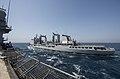 French oiler Var (A608) replenishes USS Vella Gulf (CG-72) in the Arabian Gulf on 19 June 2017.jpg