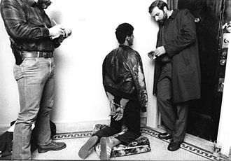 Miranda warning - Police detectives read the Miranda rights to a fugitive felon, 1984 (photography: J. Ross Baughman)