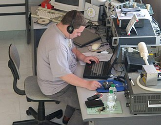 Amateur radio international operation - A DXer operates during a holiday DXpedition to Muscat, Oman.