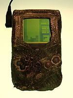 A Game Boy, damaged in the Gulf War, which still works and is now on display in the Nintendo World Store in New York.