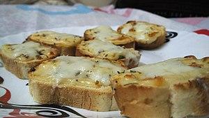 Garlic bread - Garlic bread variation topped with mozzarella cheese