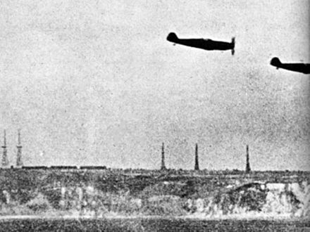 Bf 109s off Dover, 1940. British radar stations can be seen in the background. German Me 109s off Chain Home radars 1940.jpg