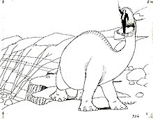 动画black-and-white image of a large dinosaur atop a cliff, with a man in a suit standing in its mouth. Several boulders can be seen in the background.