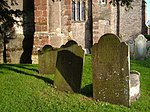 Gravestones at Berry Pomeroy In the churchyard at St Mary's. Virtually on a gridline.