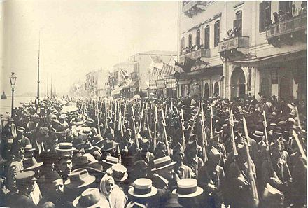 Greek troops marching on Izmir's coastal street, May 1919. Greek army Smyrne 1919.jpg