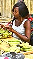 Guinean Woman Vends Bananas Two.jpg