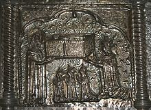 Woman handing a sarcophagus to a saint with her three daughters kneeling in front of her