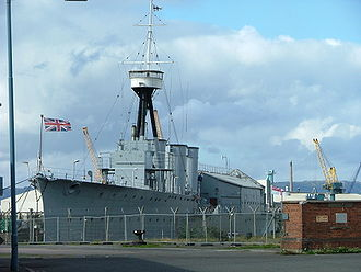 HMS Caroline (1914) - HMS Caroline sporting her three flags (From left to right) Union Flag, Commodore RNR's Broad pennant, White Ensign.