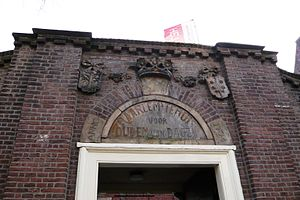 "Het Dolhuys - Keystone above entrance says ""Haarlem old age home, 1704"""