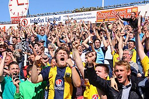 Oxford United F.C. - Oxford supporters celebrating at a 2011 away game vs Swindon Town