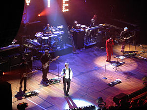Heathen Tour - At the Beacon Theatre, New York on 20 October 2002. L to R: Earl Slick (guitar), Mark Plati (guitar), Sterling Campbell (drums), David Bowie, Catherine Russell (keyboards), Gail Ann Dorsey (bass), Gerry Leonard (guitar). Mike Garson (keyboards) is out of shot to the left.