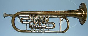 Quarter tone - Trumpet with 3 normal valves and a quartering on the extension valve (right).