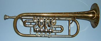 Trumpet with 3 normal valves and a quartering on the extension valve (right).