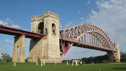 The Hell Gate Bridge in New York City inspired the final design of Sydney Harbour Bridge. Hell Gate Bridge cricket.jpg