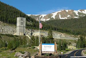 Henderson molybdenum mine - The Henderson molybdenum mine is just east of the snow-capped continental divide, which appears in the background (photo taken in mid-July, 2009)