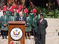 Independence Day Celebrations at the Ambassador's Residence, Harare, Zimbabwe. Ambassador Dell addresses guests while Bishop Trevor Manhanga and students from Chisipite Girls High & St. Georges Boys High look on.jpg
