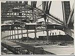 Installing overhead wiring on Harbour Bridge, 1932 (8282694017).jpg