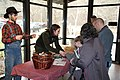 Intern Zack Curtis and Ranger Maggie Blake assist visitors with crafts at the 2018 Festival of Christmas Past, December 8, 2018--Warren Bielenberg (46269700854).jpg